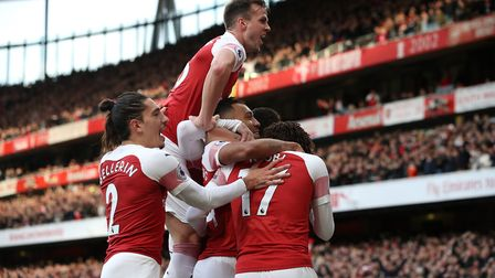 Arsenal's Pierre-Emerick Aubameyang is mobbed by team-mates after scoring his sides first goal of th