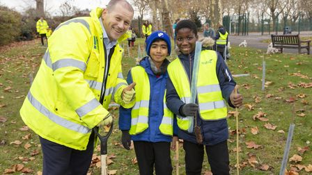 Glen Roberts, project director for Wates Residential with Newfield Primary School pupils in Roundwoo