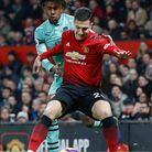 Arsenal's Alex Iwobi (left) and Manchester United's Diogo Dalot battle for the ball during the Premi