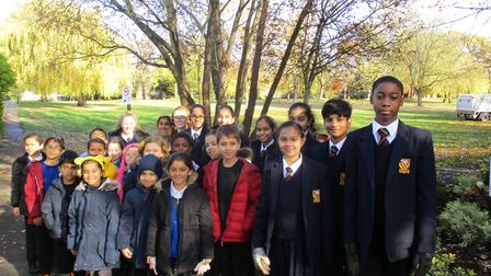 St Gregory Catholic Science College and Uxendon Manor pupils planted bulbs in Woodcock Park to raise