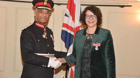 Susanna Daus is presented with her medal by by Kenneth Olisa, Lord Lieutenant for London.