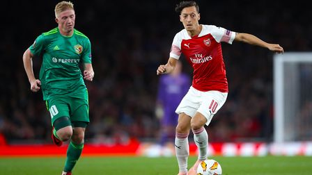 Vorskla's Vladyslav Kulach (left) and Arsenal's Mesut Ozil in action at the Emirates Stadium earlier