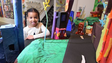 Hiyabel De Perzio (7) with the model village made by the Thursday Make Art group. Picture: Polly Han