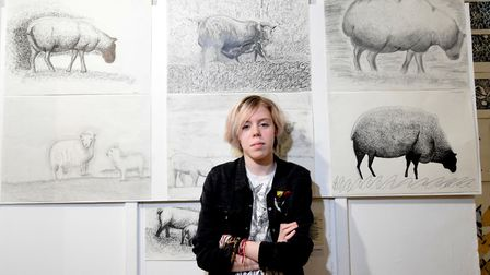 Mayzee Wooding (13) who attends Camden School For Girls with pencil drawings of sheep, hers is top r