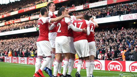 Arsenal's Pierre-Emerick Aubameyang (obscured) celebrates scoring his side's first goal of the game