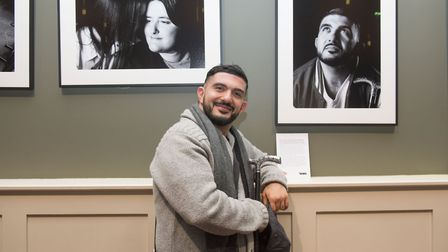 Kozan beside his portrait at the launch event on Monday, December 3. Picture: Lucy Young