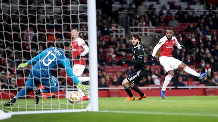Arsenal's Alexandre Lacazette (right) scores his side's first goal of the game during the UEFA Europ