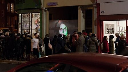 Crowds gather at the window of Tintype Gallery for the opening of Essex Road 5. Picture: Cameron Lea