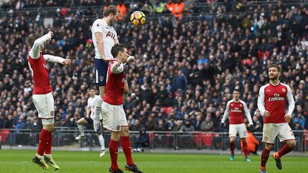Tottenham Hotspur's Harry Kane heads home to open the scoring during the Premier League match agains