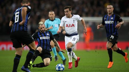 Tottenham Hotspur's Harry Winks is challenged by Inter Milan's Marcelo Brozovic during the Champions