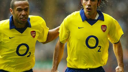 Arsenal's Robert Pires is congratulated by team-mate Thierry Henry after scoring their winner at Anf