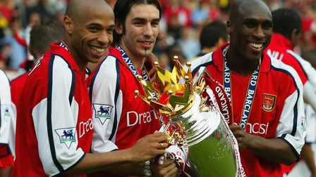 Former Arsenal players (L-R) Thierry Henry, Robert Pires and Sol Campbell celebrate winning the Prem