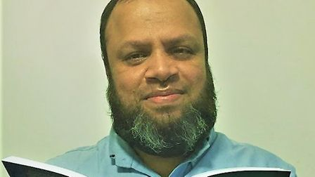 Shofi Ahmed is a poet from Upper Tollington, seen here reading from one of his poetry books. Picture