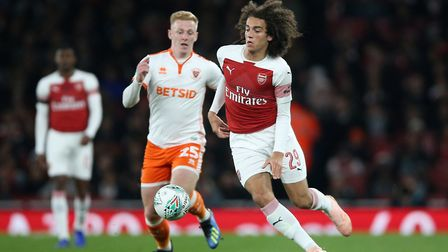 Arsenal's Matteo Guendouzi (right) and Blackpool's Callum Guy battle for the ball (pic Nigel French/