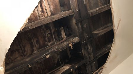 A huge hole left in the ceiling of Ms Kelly's flat in Lorraine Road. Picture: Ms Kelly