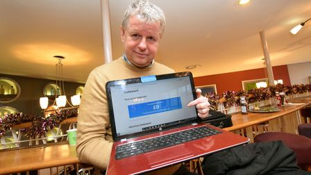Lawrence Curtis shows the screen display of his Universal Credit account. Picture: Polly Hancock