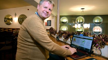 Lawrence Curtis runs his business Healthy Minds, Healthy Bods from a laptop, pictured in Weatherspoo