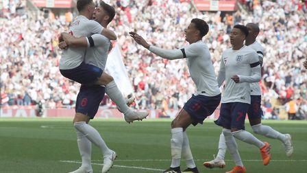 England's Gary Cahill (second left) celebrates scoring against Nigeria at Wemlbey prior to the 2018