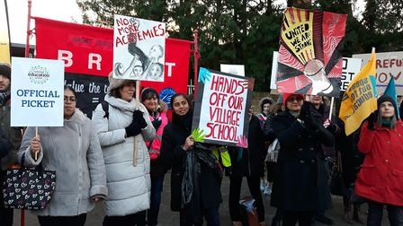 Placard-bearing protestors gathered around the gates of Kingsbury's The Village School last year. Pi