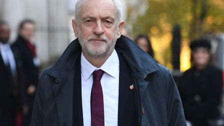 Labour leader Jeremy Corbyn walks through Downing Street ahead of the remembrance service at the Cen