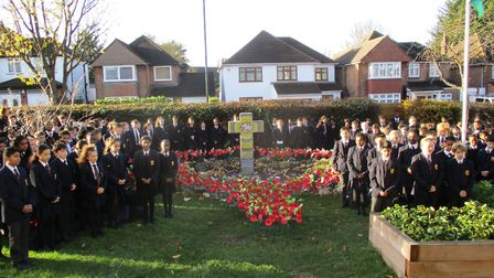 Pupils from St Gregory�s Catholic Science College plant poppies in their school's remembrance garden