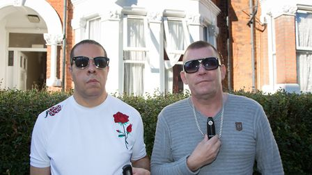 Gustavo William-Coleman and Andrew William-Coleman holding alarm devices and showing CCTV cameras al