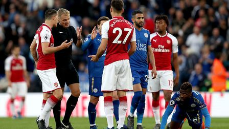 Arsenal's Konstantinos Mavropanos (27) is sent off by match referee Graham Scott during the Premier