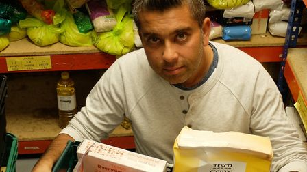 Rajesh Makwana, capacity building manager for Sufra Food Bank & Kitchen, with food supplies for Nort