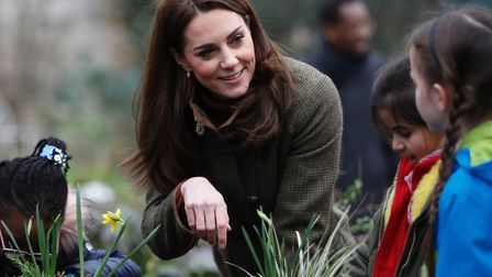 The Duchess of Cambridge speaks with children during a visit to the King Henry's Walk Garden in Isli