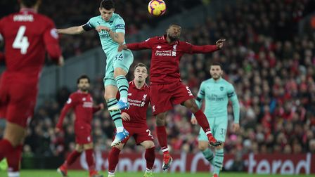 GranitXhaka of Arsenal wins the ball in the air against Georginio Wijnaldum of Liverpool in the Pre