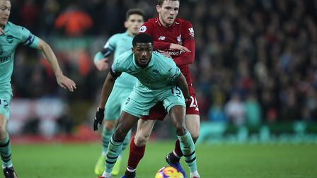 Ainsley Maitland-Niles of Arsenal holds off Andrew Robertson of Liverpool in the Premier League game