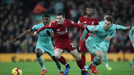 Andrew Robertson of Liverpool holds off Aaron Ramsey and Ainsley Maitland-Niles of Arsenal in the Pr