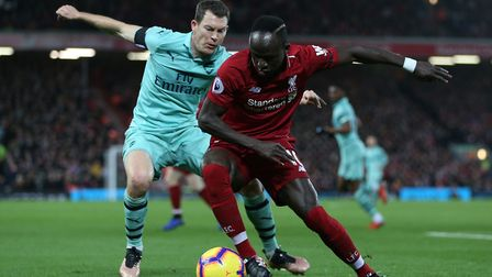 Sadio Mané of Liverpool defends against Stephan Lichtsteiner of Arsenal in the Premier League game b