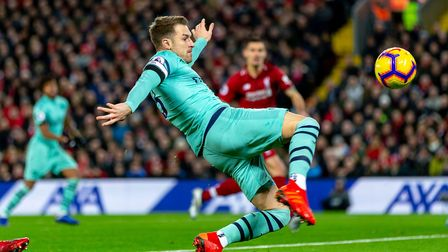 Aaron Ramsey of Arsenal stretches for a ball in the Premier League game between Liverpool v Arsenal