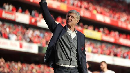 Arsenal manager Arsene Wenger salutes the fans after his final home game as manager during the Premi