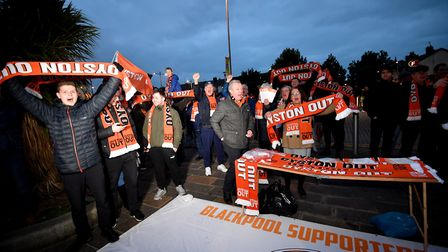 Blackpool fans outside the stadium hold up Oyston Out scarves in protest prior to the beginning of t