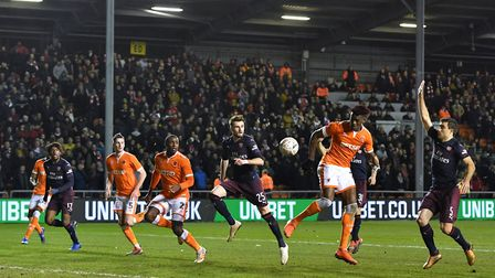 Blackpool's Armand Gnanduillet (second right) heads towards the goal but misses during the Emirates