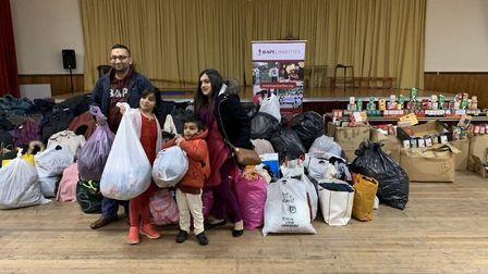Families bringing in clothes and food to Neasden Temple for distribution to homeless
