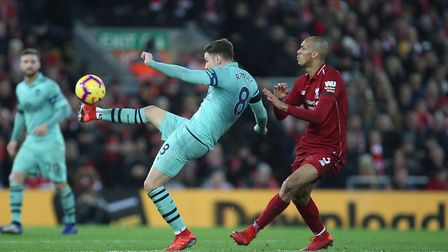 Aaron Ramsey of Arsenal hooks the ball forward in the Premier League game between Liverpool v Arsena