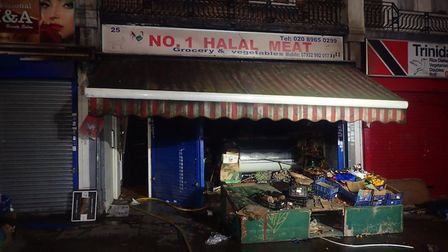 Fire at a Halal shop in Harlesden. Picture: LFB