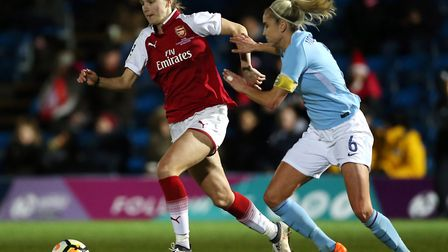 Arsenal's Vivianne Miedema and Manchester City Women's Steph Houghton battle for the ball (pic Nigel
