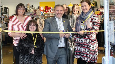 Evis Llupo, shop manager, and Marie Currie staff and volunteers at the reopening of the charity's 'f