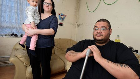 Leeann and Daniel Glasgow with daughter Abigail (2) in their living room that has mould. They live i