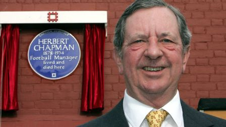 Peter Hill-Wood, chairman of Arsenal Football Club stands in front of number 6 Haslemere Avenue, in