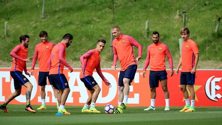 Barcelona's Jeremy Mathieu (third right) and Denis Suarez (centre) battle for the ball during a trai