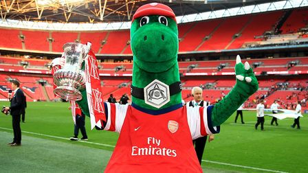 Arsenal mascot Gunnersaurus celebrates with the FA Cup trophy after the game
