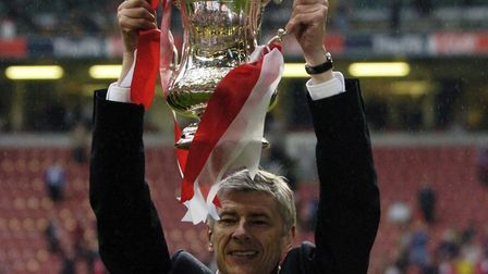 Arsenal manager Arsene Wenger lifts the FA Cup after defeating Manchester United at Cardiff in 2005.
