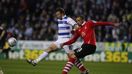 Queens Park Rangers defender Joel Lynch (right) in action for Nottingham Forest against Reading in 2