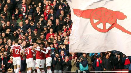 Arsenal's Pierre-Emerick Aubameyang (hidden) celebrates scoring his side's second goal of the game w