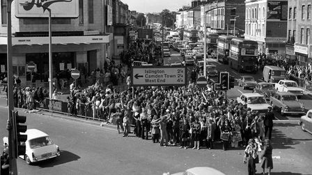 1973, the year after the Bowie show: a crowd of screaming teenagers besiege the Rainbow Theatre in F